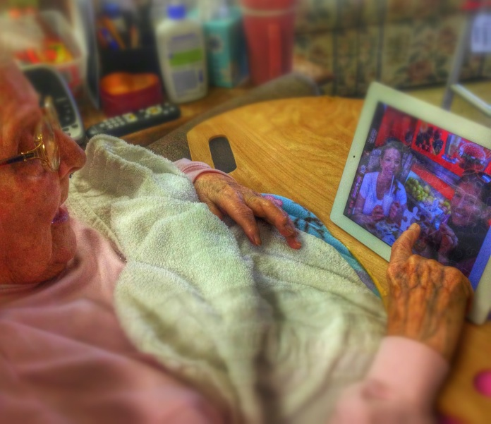 Grandma finishing a puzzle of my sister and I on an iPad (Image/editing credit: mine)